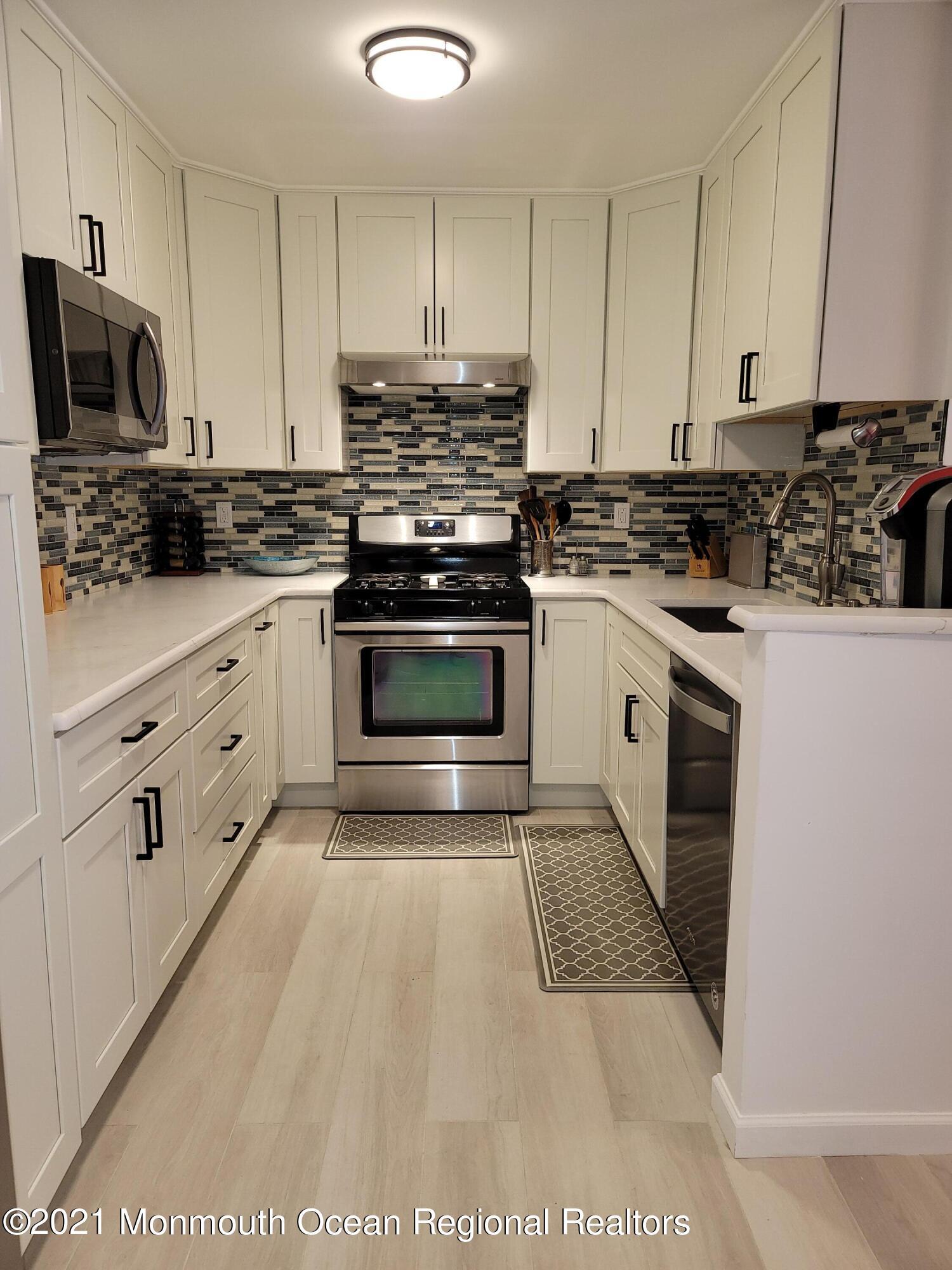 915 Crimson Court, Morganville, New Jersey 07751, 3 Bedrooms Bedrooms, ,3 BathroomsBathrooms,Townhouse,For Sale,915 Crimson Court,2,22107690